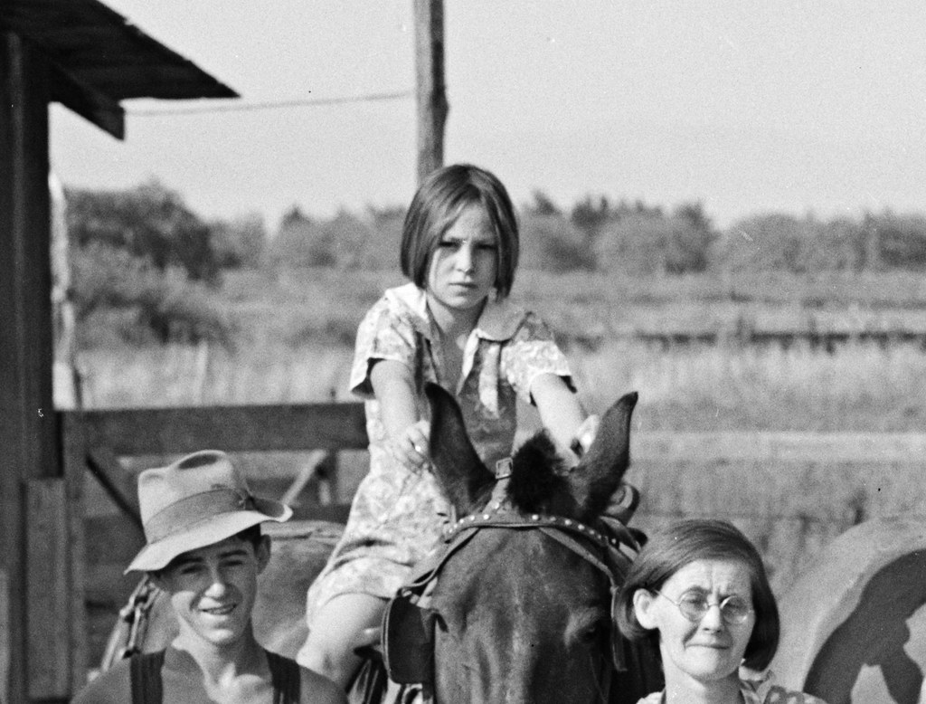 Lois Adolf, her mother and a brother, cropped from photo: Washington, Yakima Valley, near Wapato. Rural Rehabilitation Farm Security Administration. Chris Adolf, his wife, six of their eight children and his teams. August 1939