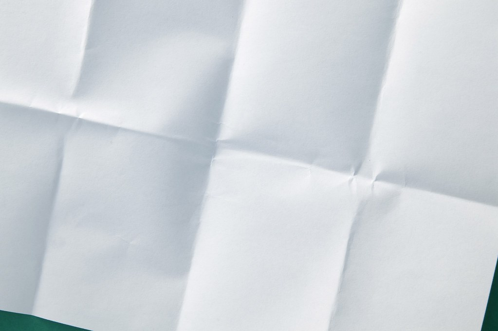creased white paper  a sheet of paper folder into 8 and