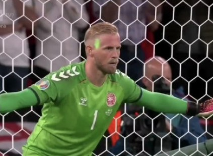 A laser pointer is directed towards Kasper Schmeichel from the stands.