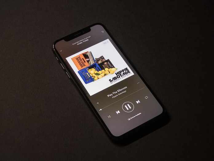 HD wallpaper: space gray iPhone X showing Spotify application ...