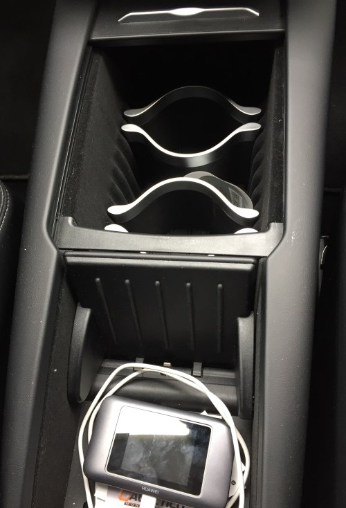 small resolution of the tesla center console that is now provided in the model s is pretty slick imho i like the way the covers open and close which is smoother than our
