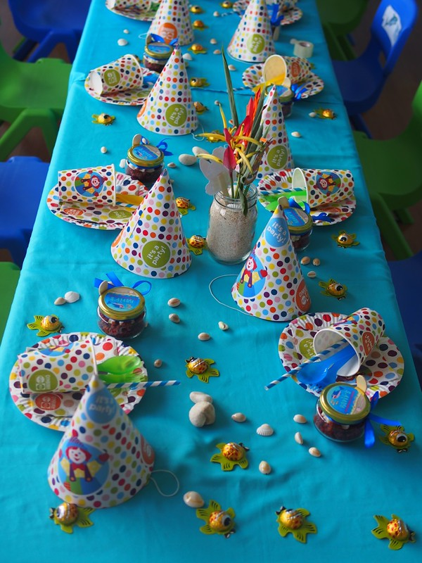 matching Gymboree plates, cups and, table napkins and party hats