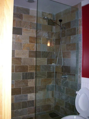 waterfall shower with fixed glass wall  Uday Gajendar