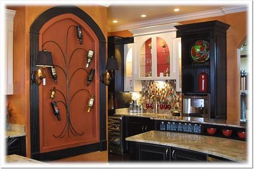 black cabinetry and wine tree  These black cabinets mix