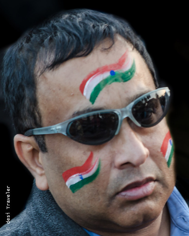 A man with Indian flag painted on his face Wagah Border Parade