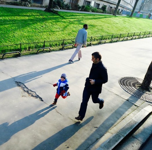 man running with child