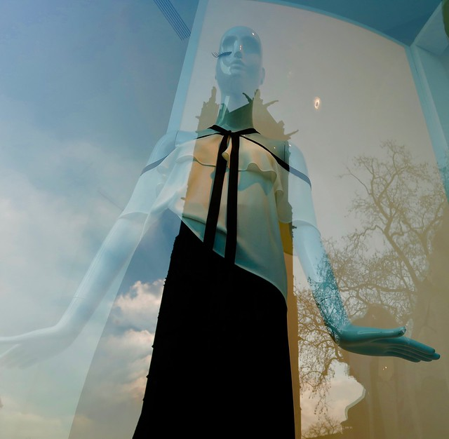 mannequin with reflection of tower and tree