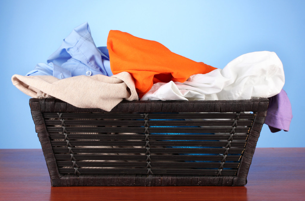 Bright Clothes In Laundry Basket On Color Background Flickr