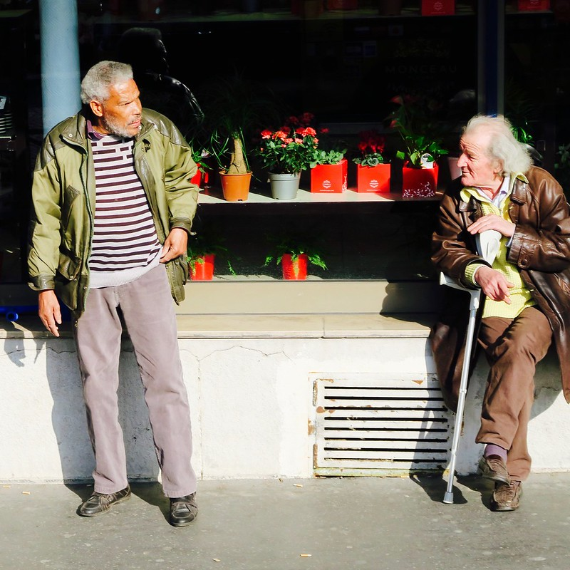 men in front of a flower shop