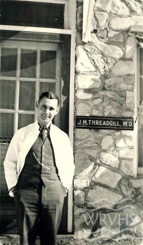 Dr. Threadgill, standing in front of his office.