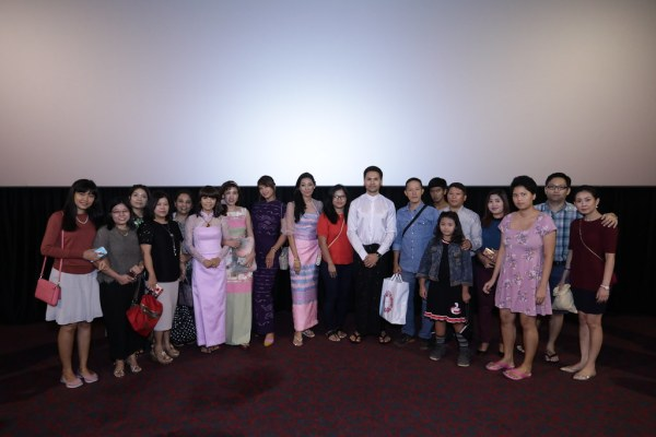 Christina (in pink longyi and short hair), and other members of the cast (in traditional Burmese costume) gamely posed for picture after picture. (Credit: Golden Village)