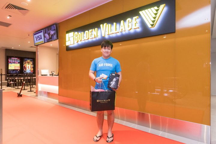 The early bird catches the worm: Mr Adam Lee with his prize. Photo: Golden Village