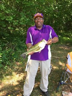 Photo of man holding largemouth bass