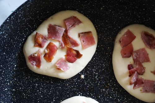Cooking gluten free American style bacon pancakes.
