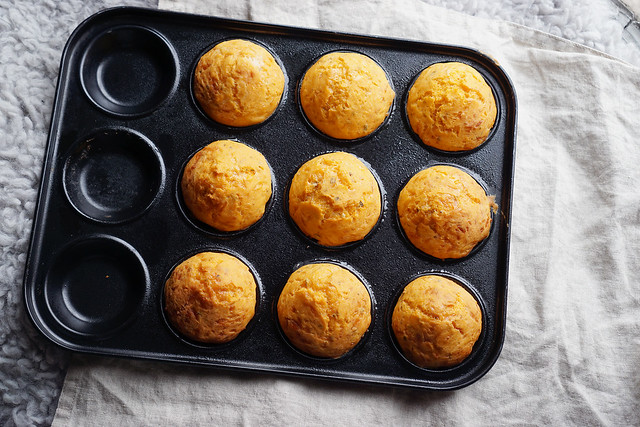 Gluten free mini cheese muffin rolls with a hint of garlic, tomato and oregano