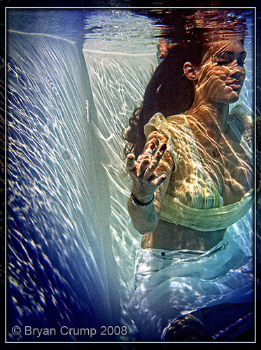 Girl Swimming under water sitting in meditation pose Fir