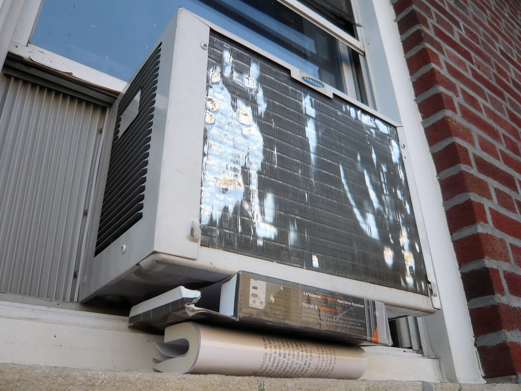makeshift AC Window Unit support  consisting of an empty
