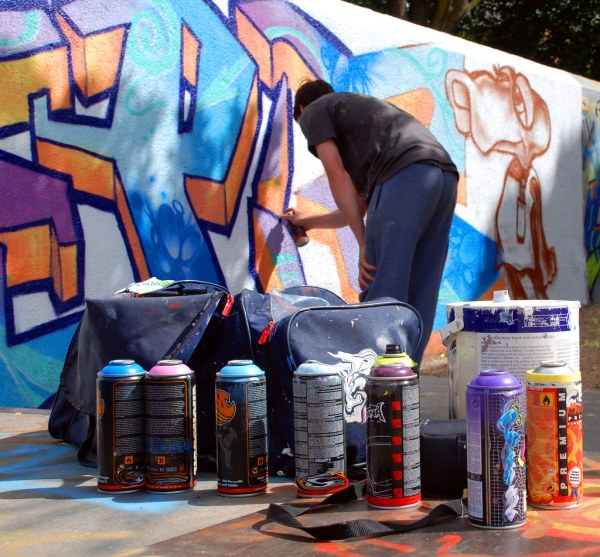 Graffiti Artist Work With Tools Of