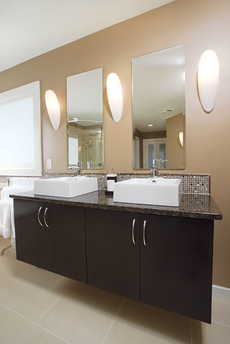 modern bathroom two sinks dark brown wood cabinets  Flickr