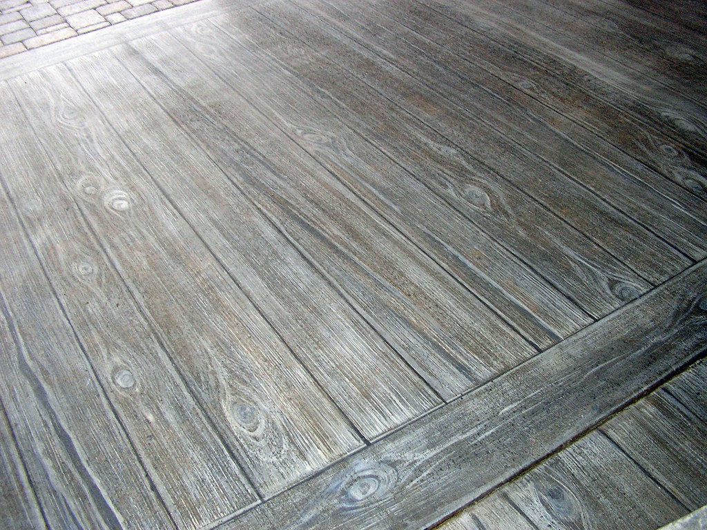 Faux wood finish on concrete patio  This was an old