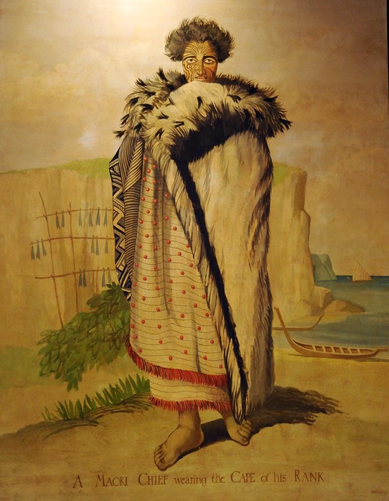 A Maori Chief wearing the Cape of his Rank tattoos fur
