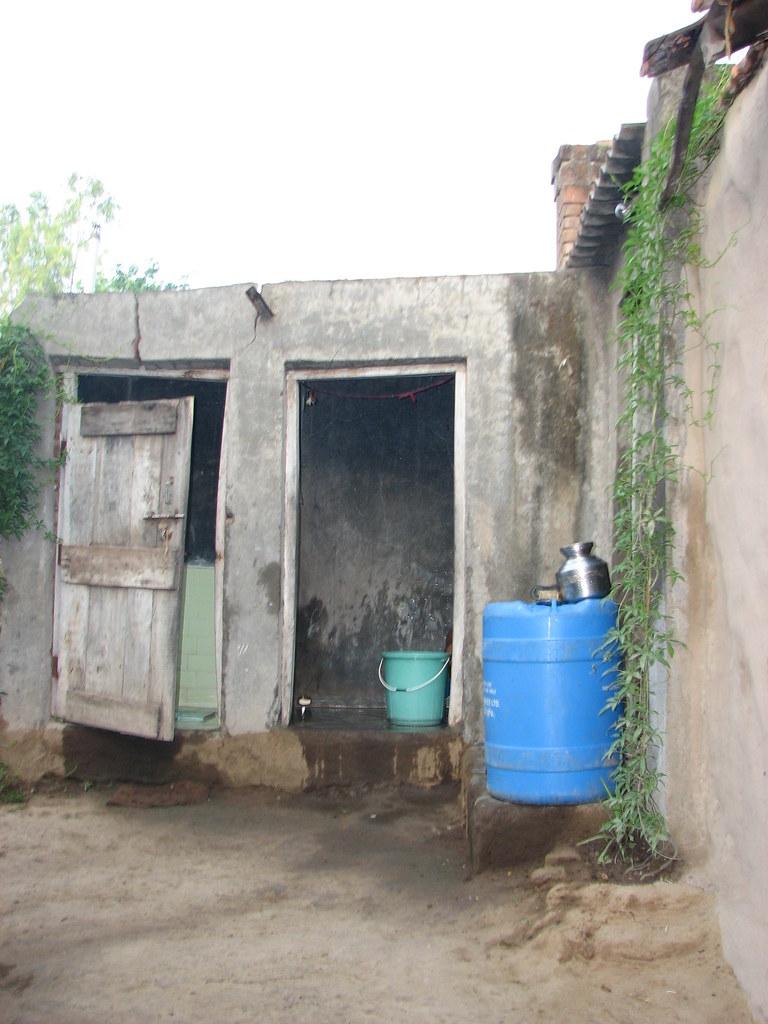 Toilet and bathroom in Tambhol Village India  Toilet and