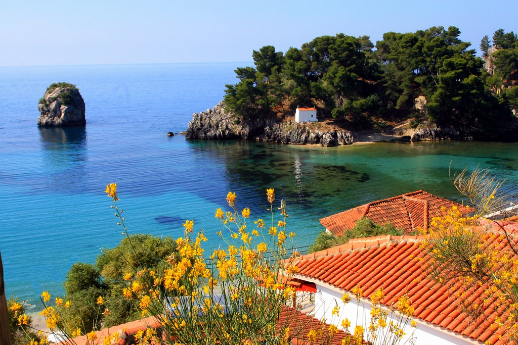 Scenery Parga Epirus  Red tiled roofs and islet with
