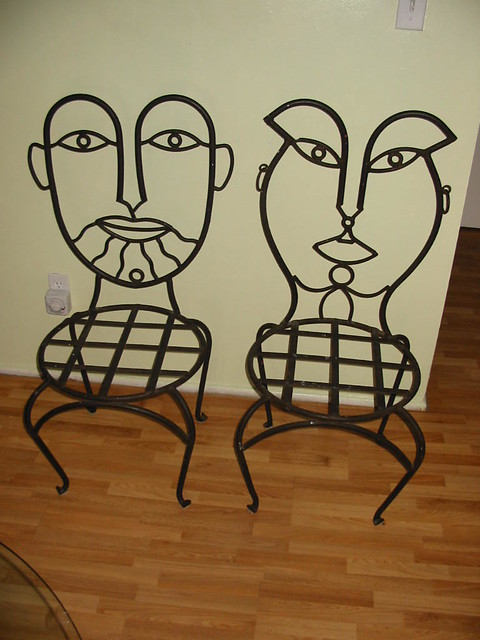 WroughtIron Chairs Faces on the back  22500 Each one