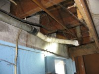 kitchen leak damage, note drain is galvanized pipe to PVc ...