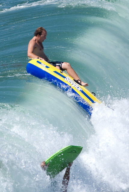 Going Down A Guy On A Raft Trying To Hold His Own With