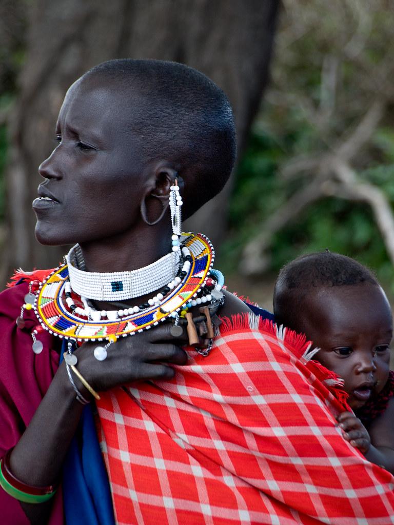 Maasai Woman and Baby  Maasai woman carrying her baby in