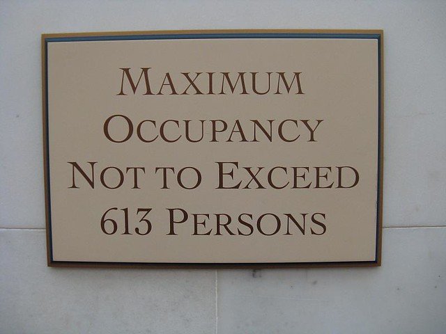 maximum occupancy not to exceed 613 persons sign  Vote NO
