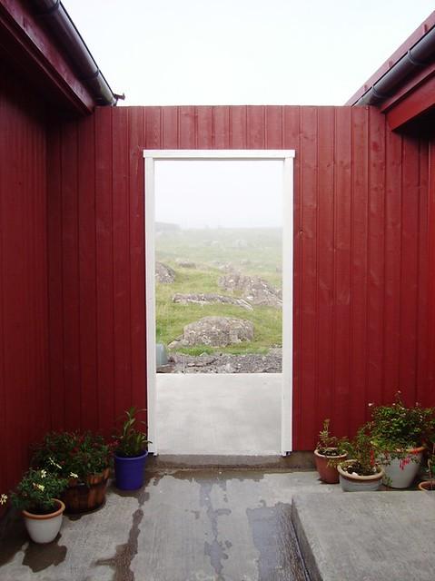 Door between house and garage  This open air door is