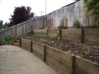 Retaining wall with 2x12 pressure treated wood 2