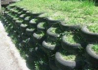 Tire retaining wall | Way to recycle! | Troy Aker | Flickr