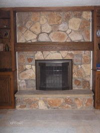 New mantle, fireplace cover, and tile in front of fireplac ...