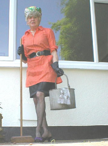 1960s style Charwoman in orange nylon overall  1960s style   Flickr