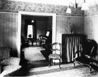 Living room of the Lodge, around 1920. This photo has a co ...
