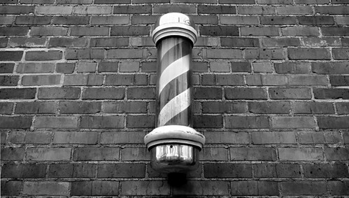 3d Grey Brick Wallpaper Barber Shop Pole Barber Shop Pole On A Brick Wall
