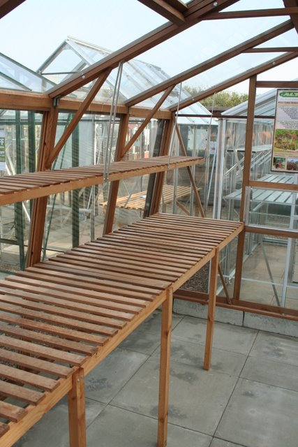Wood greenhouse staging  This garden feature image is in
