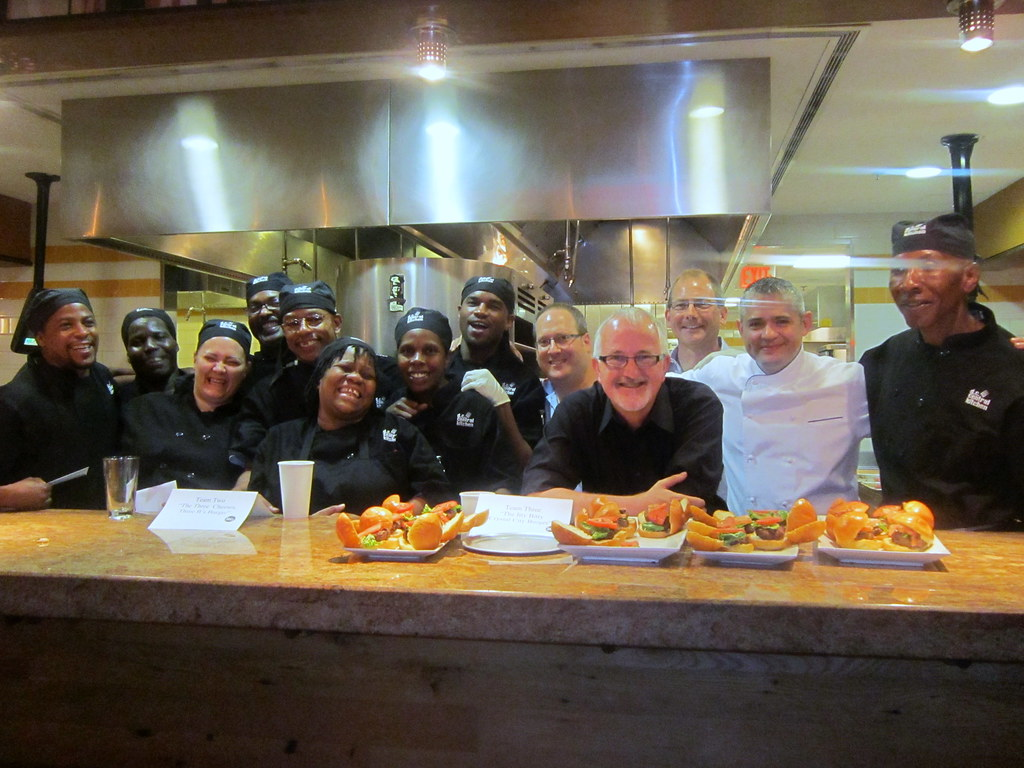Students pose with judges and burgers  DC Central Kitchen