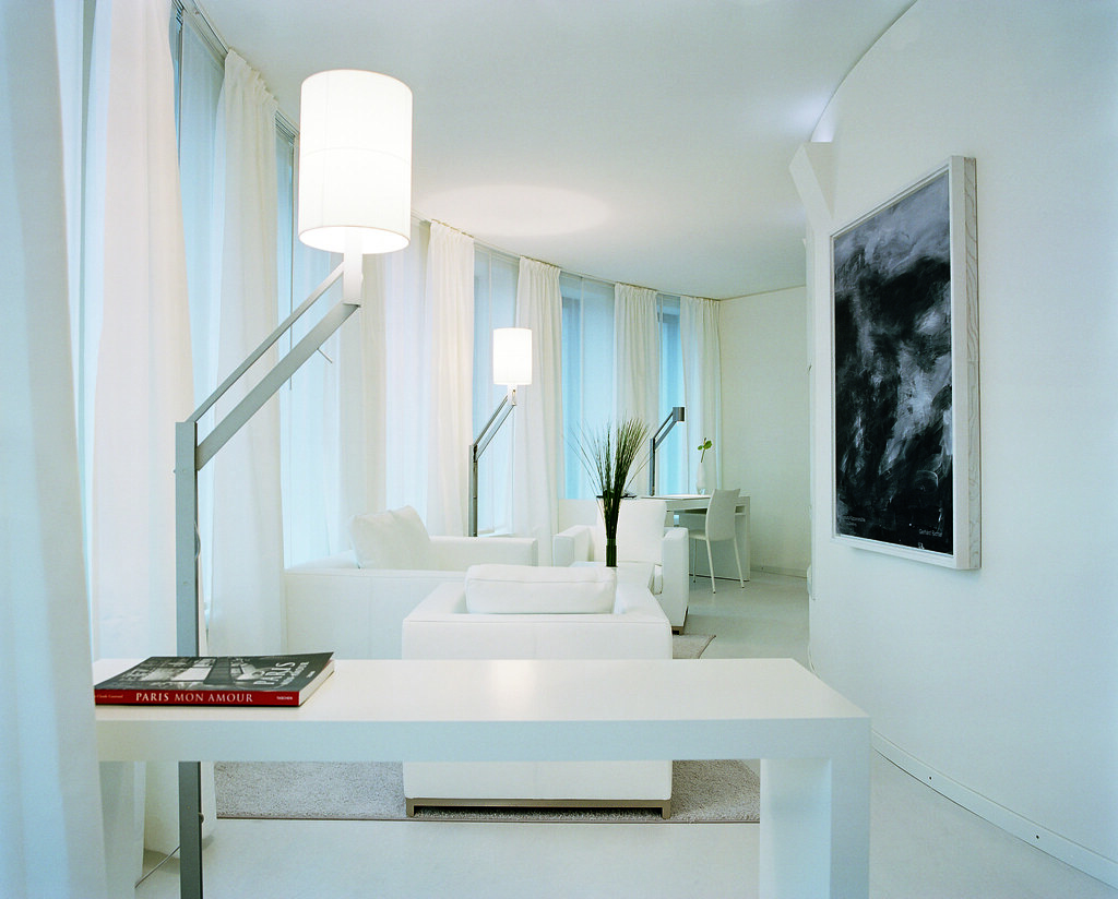 Futuristic white living room of the Suite Blanche at the H