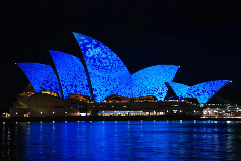 Blue opera and relectoins shades on the water sydney opera
