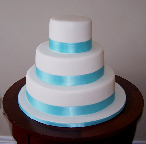 Tiffany Blue Ribbon Wedding Cake Covered In Fondant