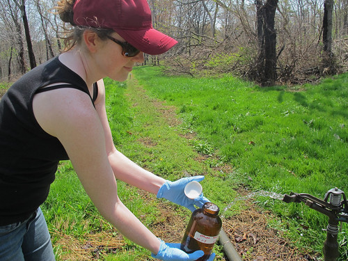 Penn State University doctoral candidate Alison Franklin collecting samples of treated wastewater