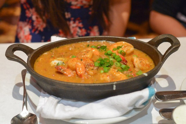 "Jumbo Louisiana Shrimp ""en Cocotte"" roasted jalapeño cheese grits, andouille & green onion sausages"
