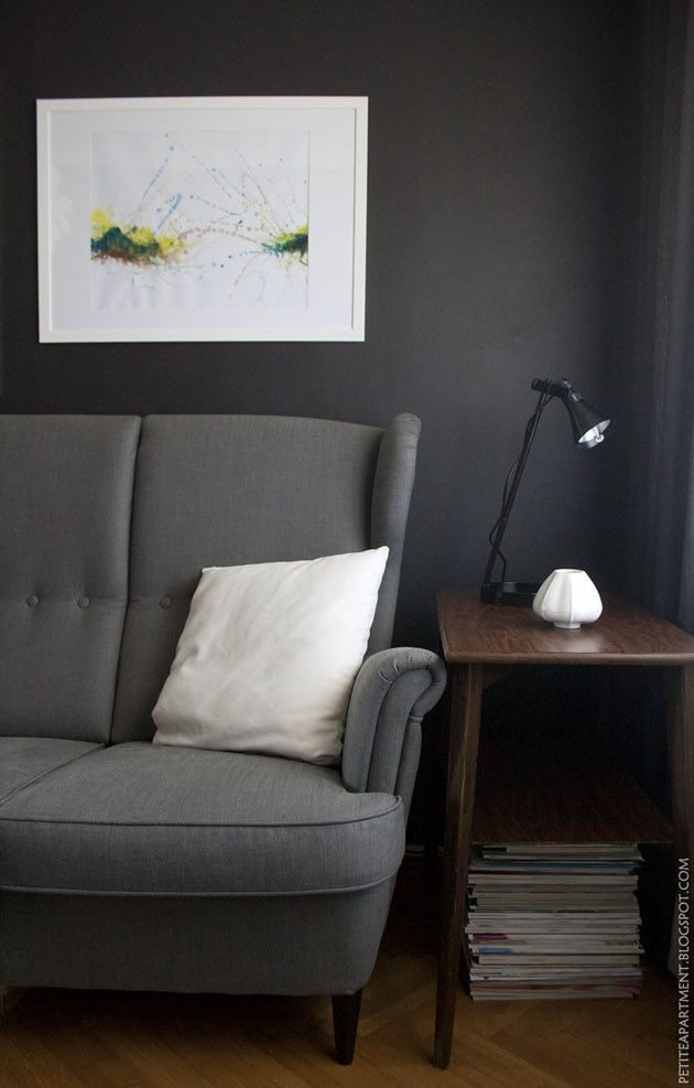 dark grey black living room with grey ikea strandmon sofa