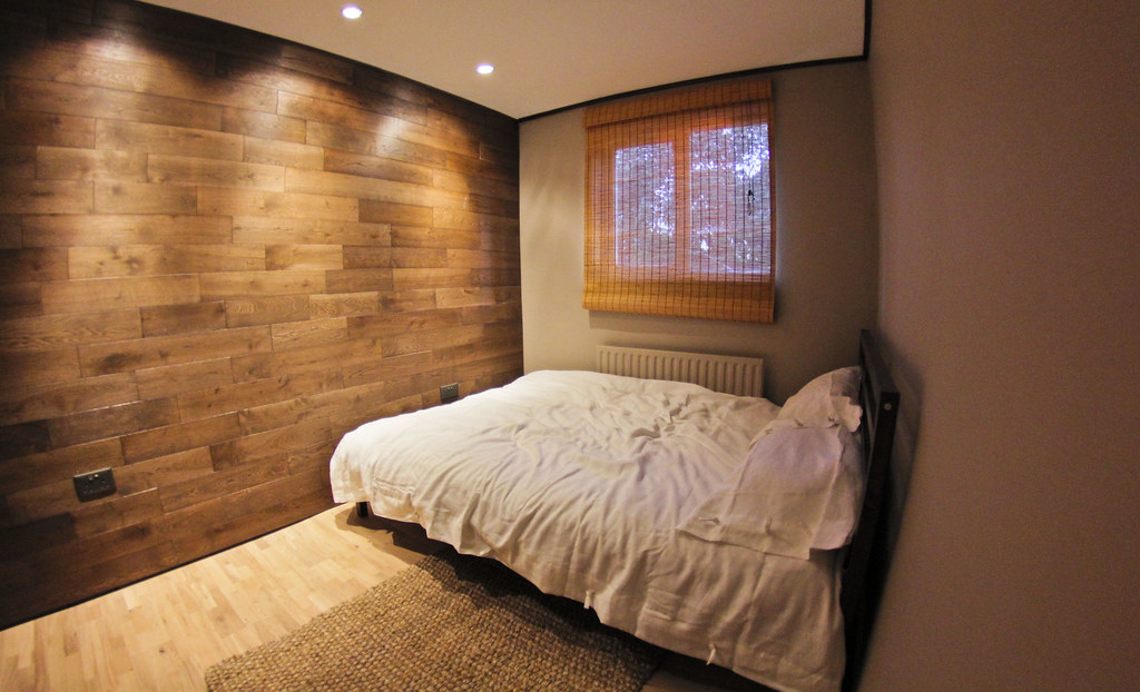 Wood Themed Bedroom  Revamped spare room with wood floor