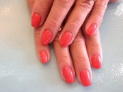 acrylic nails with coral polish