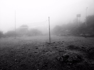 volleyball field on mount kinabalu laban rata dipped in fog
